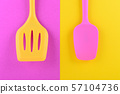 bright kitchen utensils on yellow and pink background, creative idea 57104736