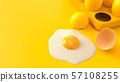 Fried egg on yellow background. 57108255