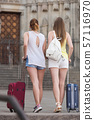 female tourists exploring old european city with baggage 57116970