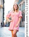 Girl walking in Barcelona streets 57117198