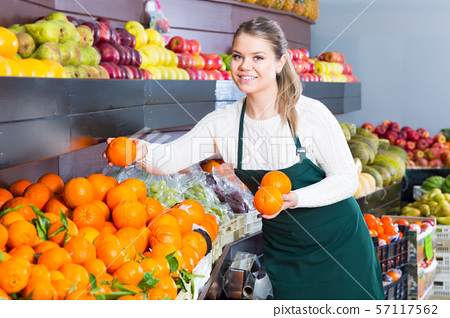 Nice woman selling fresh oranges and fruits 57117562