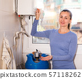Woman setting up gas boiler 57118262