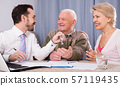 Old man and woman sign rent agreement 57119435