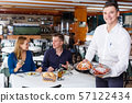 Waiter with tray of crustaceans 57122434