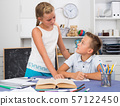 Sister is helping brother with homework 57122450