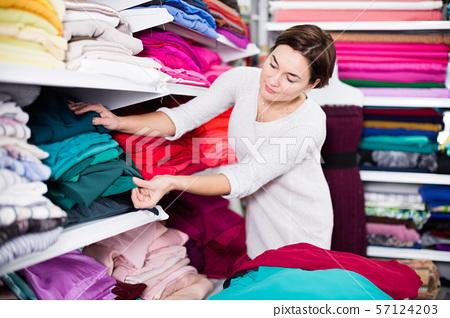 Woman choosing fabric 57124203