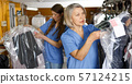 Two women working at dry-cleaning salon 57124215