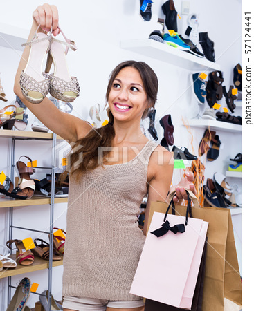 young woman in shoes store. 57124441