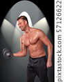 Shirtless man with dumbbell 57126622