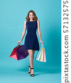 young woman in dress and hand holding shopping bag 57132575