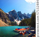 Canoes on a jetty at Moraine lake in Canada 57132884