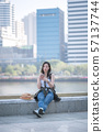 Beautiful asian tourist woman relaxing and enjoying listening the music on a smartphone 57137744