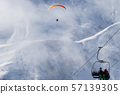 Chairlift and paraplane on ski resort at cold 57139305