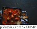 Eating meatballs and tomato sauce. Family dinner 57140585