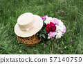 Basket with peony flowers 57140759