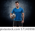 Football player with ball on field of stadium 57140998