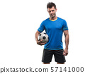 Football player with ball on field of stadium 57141000