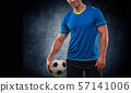 Football player with ball on field of stadium 57141006