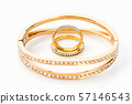 Gold wedding rings on white background 57146543