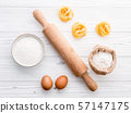 Ingredients for homemade pasta  flour and eggs on 57147175