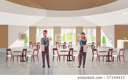 professional waiters couple standing together man woman restaurant workers in uniform holding 57149433