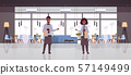professional waiters couple holding menu warmly welcoming to cozy restaurant man woman workers in 57149499