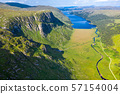 Aerial view of the Glenveagh National Park with castle Castle and Loch in the background - County 57154004