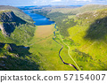 Aerial view of the Glenveagh National Park with castle Castle and Loch in the background - County 57154007