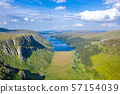 Aerial view of the Glenveagh National Park with castle Castle and Loch in the background - County 57154039