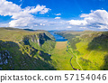 Aerial view of the Glenveagh National Park with castle Castle and Loch in the background - County 57154046