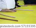 People in kimono on martial arts weapon training seminar 57155395