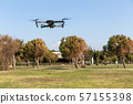A drone with digital camera flying in the park 57155398