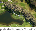 Aerial photo of green golf fields in spring 57155412