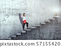 Side view of young businesswoman climbing the stairs with idea lamp on concrete background 57155420