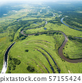 Aerial landscape of winding river in green fields 57155424