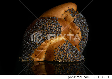 Twisted poppy seed bun isolated on black glass 57164581