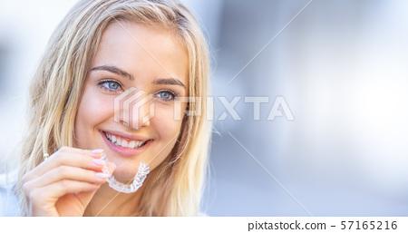 Invisalign orthodontics concept - Young attractive 57165216