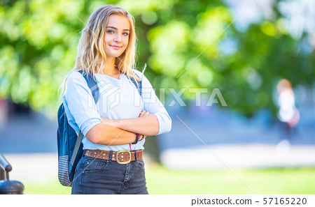 Female high school student with schoolbag. 57165220