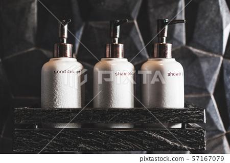 Metal bottles of shampoo, conditioner, shower gel 57167079