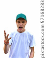 Young man with green cap screaming and motivating 57168283