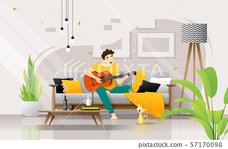 Happy young man playing guitar on sofa in living room, relaxing weekend at home 57170098