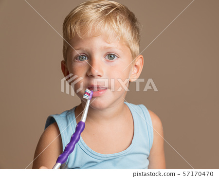 Child boy brushing her teeth 57170470