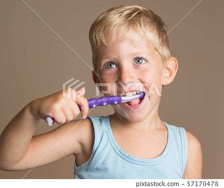 Baby boy smiling and brushing her teeth 57170478