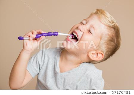 Kid boy brushing teeth 57170481