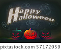 Halloween pumpkin glowing on black board BG with 57172059