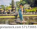 Young woman tourist in Taman Tirtagangga, Water palace, Water park, Bali Indonesia 57173665