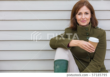 Happy Attractive Middle Aged Woman Drinking Coffee 57185795