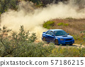 Sports Car on a Bend and a lot of Dust 06 57186215