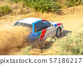 Sports Car on a Bend and a lot of Dust 04 57186217