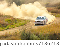 Sports Car on a Bend and a lot of Dust 03 57186218
